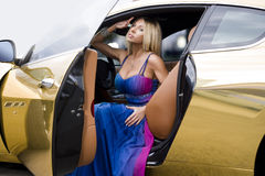 The sexual blonde in car salon Stock Images