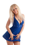 Sexual blonde in a dark blue dress Royalty Free Stock Image