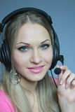 Sexual blonde in earphone with mike Royalty Free Stock Images
