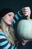 Sexual blonde keeps pumpkin Stock Photo