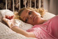 Sexual blonde lying on a bed Royalty Free Stock Photo