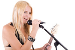 Sexual blonde and microphone Royalty Free Stock Photo