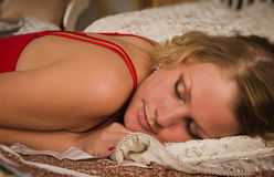 Sexual blonde in red sleeping Royalty Free Stock Photo