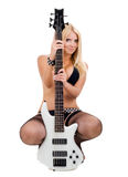 Sexual blonde and a white bass guitar Royalty Free Stock Images