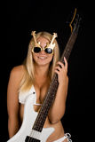 Sexual blonde and a white bass guitar Stock Images