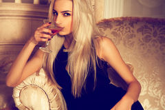 Sexual blonde woman drink martini Stock Image