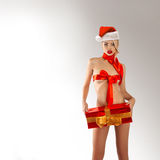 Sexual blonde woman with gift in santa hat Royalty Free Stock Images