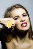 Sexual blonde woman portrait with orange Stock Image