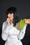 The sexual brunette with grapes Stock Photo