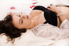 Sexual brunette sleeping Royalty Free Stock Image