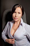 Sexual Businesswoman in the office over black background Stock Photo