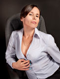 Sexual Businesswoman in the office over black background Stock Photos