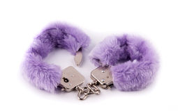 Sexual cuffs with purple fur. On a white background Royalty Free Stock Photo
