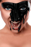 Sexual female with black paint on face screaming Stock Photo