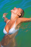 Sexual girl bathes in the sea Royalty Free Stock Photo