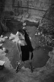 Sexual girl in black dress inside stone quarry Stock Photo