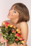 Sexual girl with a bouquet of roses Royalty Free Stock Images