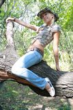 Sexual girl in cowpuncher cloth Stock Photo