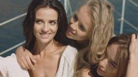 Sexual girl on luxury yacht make selfie stock photos
