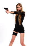 Sexual girl with a pistol. On a white background Royalty Free Stock Image