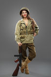 Sexual Girl soldier with tommy gun. Sexual Girl soldier posing with tommy gun royalty free stock images