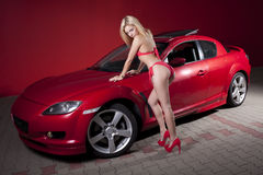 Sexual girl and the sports car Royalty Free Stock Photo