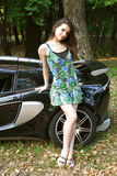 The sexual girl in standing near the sport car stock image