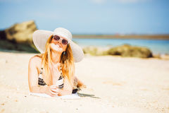 Sexual happy blond girl with sunglasses and white Royalty Free Stock Photo