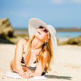 Sexual happy blond girl with sunglasses and white Royalty Free Stock Image
