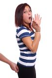 Sexual harassmant. Man pinching a young woman's bottom from behind Stock Photo