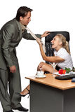 Sexual harassment. Pretty businesswoman, draws the employee for its necktie on a white background Royalty Free Stock Photography
