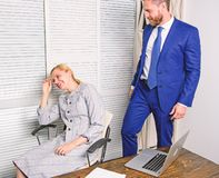 Sexual harassment between colleagues and flirting in office. Workplace bullying concept. Bullying at work. Sexual harassment between colleagues and flirting in royalty free stock image