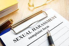 Sexual harassment complaint form. Sexual harassment complaint form on a desk stock image