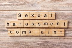 Sexual harassment complaint word written on wood block. Sexual harassment complaint text on table, concept.  stock photography