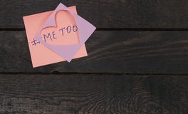 Sexual harassment concept, abuse, molestation.Written the text me too on pink sticker.  Stock Photo