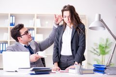 The sexual harassment concept with man and woman in office. Sexual harassment concept with men and women in office Stock Photo