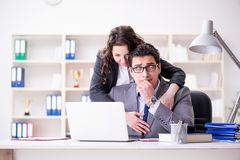 The sexual harassment concept with man and woman in office. Sexual harassment concept with men and women in office Royalty Free Stock Images