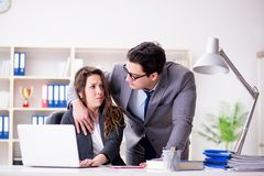 The sexual harassment concept with man and woman in office. Sexual harassment concept with men and women in office Royalty Free Stock Photos