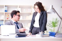 The sexual harassment concept with man and woman in office. Sexual harassment concept with men and women in office Royalty Free Stock Photo
