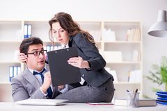 The sexual harassment concept with man and woman in office. Sexual harassment concept with men and women in office Stock Image