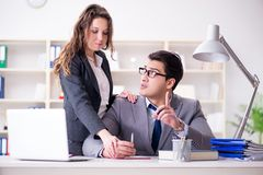 The sexual harassment concept with man and woman in office. Sexual harassment concept with men and women in office stock images