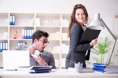 The sexual harassment concept with man and woman in office stock images