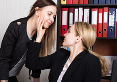 Sexual harassment. female boss sexually molested the female employee Stock Images