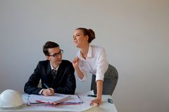 Sexual harassment in office. Boss stares at secretary royalty free stock images