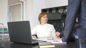 Sexual harassment in the office. two, a man and a woman in the office. Sexual harassment in the office. two, a men and a women in the office royalty free stock images