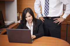 Sexual harassment at the office Royalty Free Stock Photos