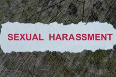 Sexual harassment word on a cut out newspaper. Concept Royalty Free Stock Photos