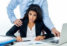 Sexual harassment at work. Disgusted employee being molested by her boss royalty free stock image