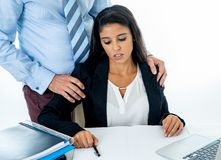Sexual harassment at work. Disgusted employee being molested by her boss. Uncomfortable scared woman being harass by her boss at office in Sexual harassment at royalty free stock image