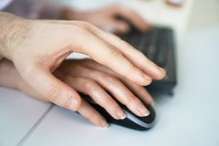 Sexual harassment at work. Man touching secretary`s hand Royalty Free Stock Photos